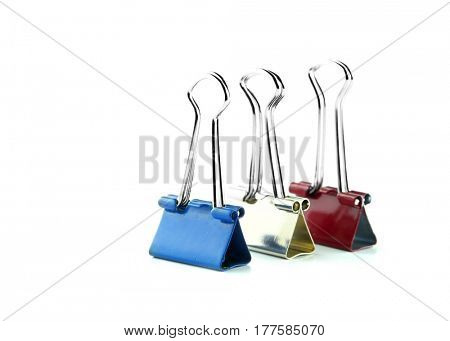 Three paper clips against white background