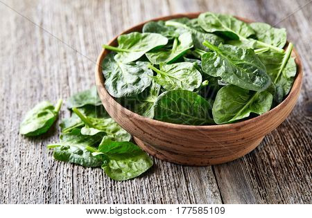 Baby spinach in a wooden plate
