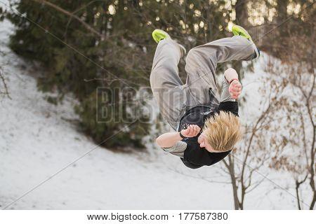 Backflip parkour jumping in winter snow park - free-run training, hotizontal