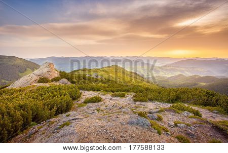 majestic mountain sunrise and colored sky with clouds