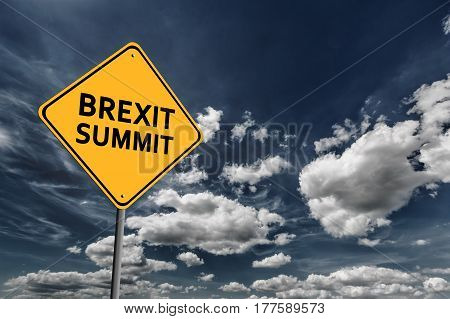 Background of dark blue sky with cumulus clouds and yellow road sign with text Brexit Summit