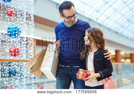 Father shopping with little daughter on her birthday
