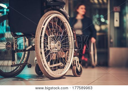 Two disabled women waiting for elevator in a departmetn store