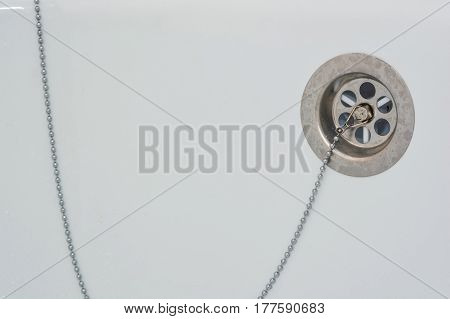 Overflow-prevention device with lead and chain in bathtub