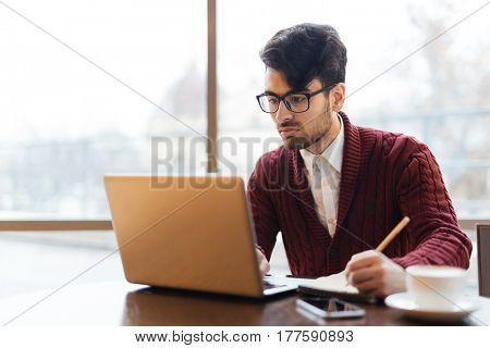 Serious broker planning work or rewriting data from laptop display