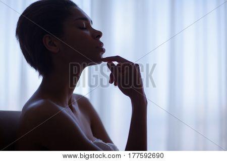 Beautiful Woman Resting Near A Window