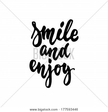 Smile and enjoy - hand drawn lettering phrase isolated on the white background. Fun brush ink inscription for photo overlays, greeting card or t-shirt print, poster design