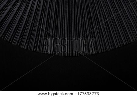 Black pleated fabric with empty place. Plisse fabric texture  background.