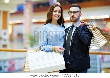 Modern couple with paperbags shopping on weekend