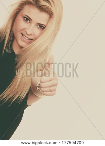 Smiling Blonde Woman Making Thumb Up Gesture