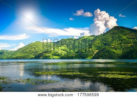 Beautiful green hills landscape with reflection on water at Phewa lake, Pokhara. Relax after trekking in Himalaya mountains, Nepal. Nature landscape. Travel background. Holidays and recreation
