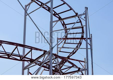 Rollercoaster against blue sky in the evening.