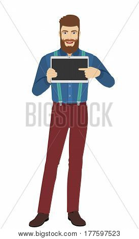 Hipster pointing at digital tablet PC. Full length portrait of hipster in a flat style. Vector illustration.