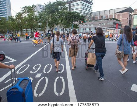 Taipei Taiwan - October 02 2016: The unusual pedestrian crossing on a typical Taiwanese street. Pedestrians going through all the possible directions