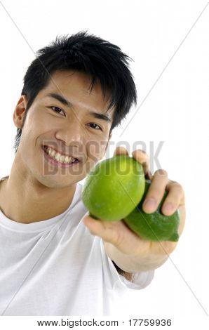 young man showing lemon