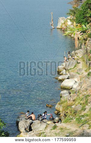 Mayan Indigenous Washing Clothes And Taking A Bath On The Coast Of San Pedro On Lake Atitlan