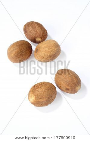 group of nutmegs isolated on a white background