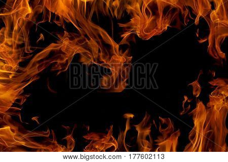 Fire flame isolated on black background. Fire frame with empty place for your design.