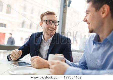 Successful trader explaining his colleague how to increase sales level