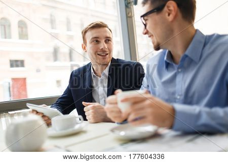 Modern bankers having discussion during business lunch
