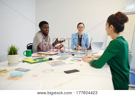 Businessman explaining his point of view to young woman