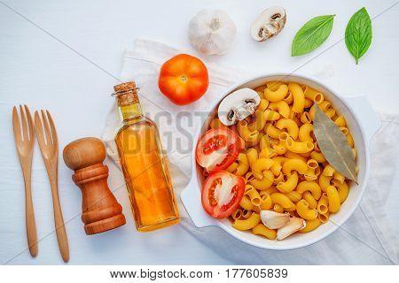 Italian Foods Concept And Menu Design . Pasta Elbow Macaroni  With Ingredients Sweet Basil ,tomato ,