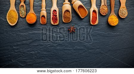 Various Of Indian Spices And Herb In Wooden Spoons. Flat Lay Of Spices Ingredients Chilli ,pepper, G