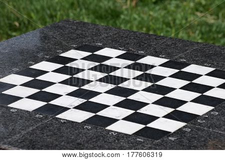empty chessboard made of stone in the park