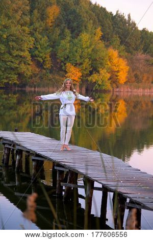Beautiful Woman On A Wooden Bridge