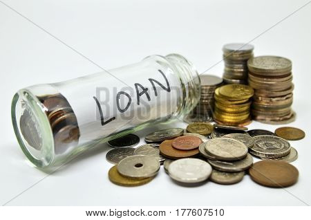 Loan Lable In A Glass Jar With Coins Spilling Out