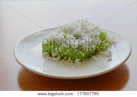 green coconut sweet pudding on white plate