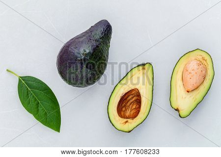 Close Up Fresh Afresh Avocado And Avocado Leaves On Marble Background Flat Lay And Copy Space.