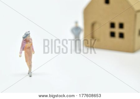 Women is leaving her man and house. Relationship concept