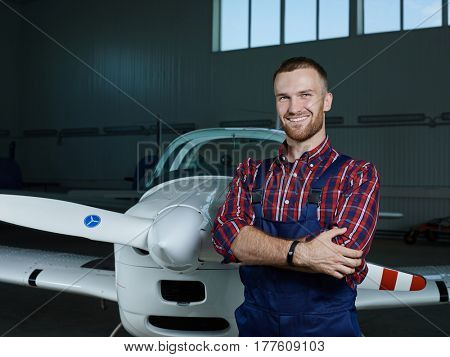 Smiling man in uniform working as maintenance mechanic