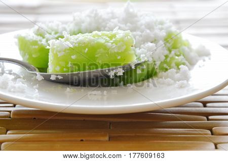 green coconut sweet pudding on silver spoon