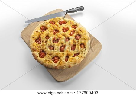 Apulian flat bread with tomatoes on cutting board and knife