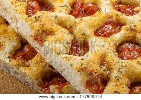 Detail of cut Apulian flat bread with tomatoes