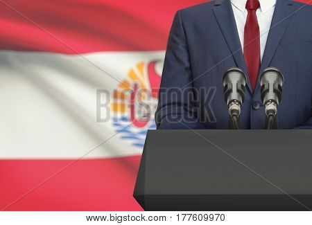 Businessman Or Politician Making Speech From Behind A Pulpit With National Flag On Background - Fren
