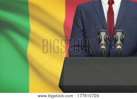 Businessman Or Politician Making Speech From Behind A Pulpit With National Flag On Background - Mali