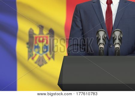 Businessman Or Politician Making Speech From Behind A Pulpit With National Flag On Background - Mold