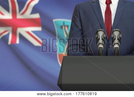 Businessman Or Politician Making Speech From Behind A Pulpit With National Flag On Background - Mont