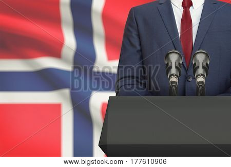 Businessman Or Politician Making Speech From Behind A Pulpit With National Flag On Background - Norw