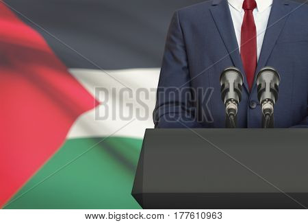 Businessman Or Politician Making Speech From Behind A Pulpit With National Flag On Background - Pale
