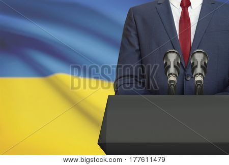 Businessman Or Politician Making Speech From Behind A Pulpit With National Flag On Background - Ukra