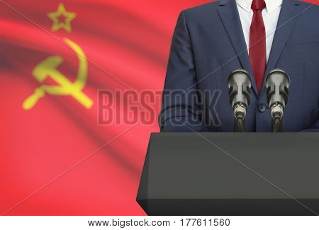 Businessman Or Politician Making Speech From Behind A Pulpit With National Flag On Background - Ussr