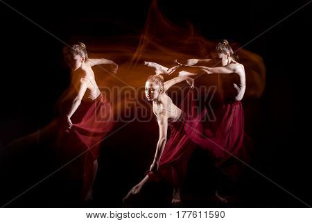 The sensual and emotional dance of beautiful ballerina. Photography technique with strobe