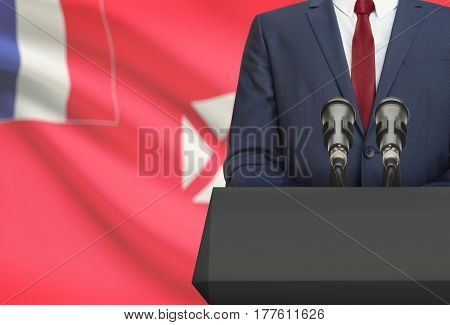 Businessman Or Politician Making Speech From Behind A Pulpit With National Flag On Background - Wall