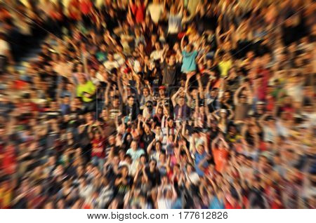 Blurred, Defocused Crowd Of Spectators On A Stadium Tribune