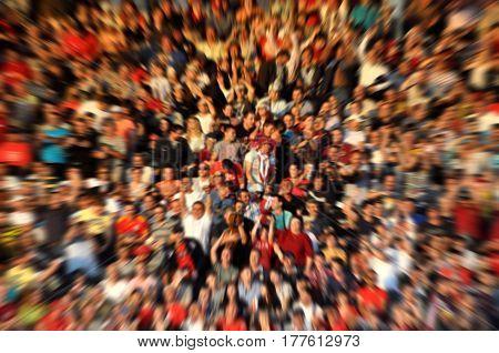 Blurred Crowd Of Spectators On A Stadium Tribune