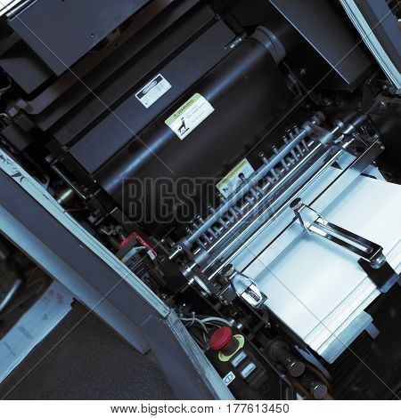 Mechanism of an offset printing machine. Macro photo